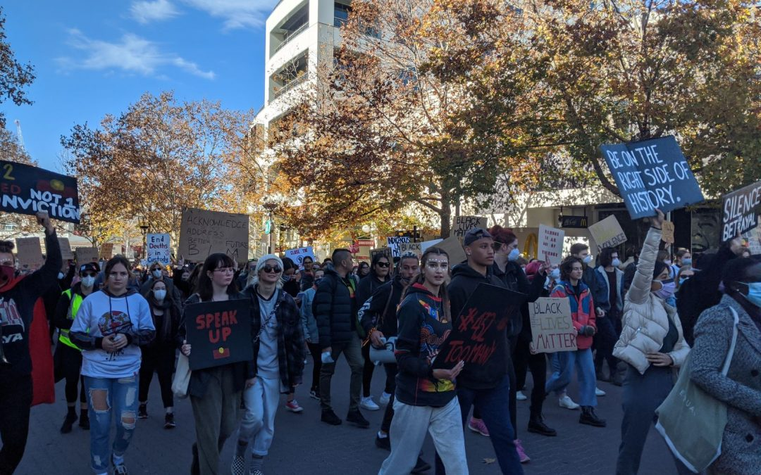 Indigenous rights activists march in Canberra